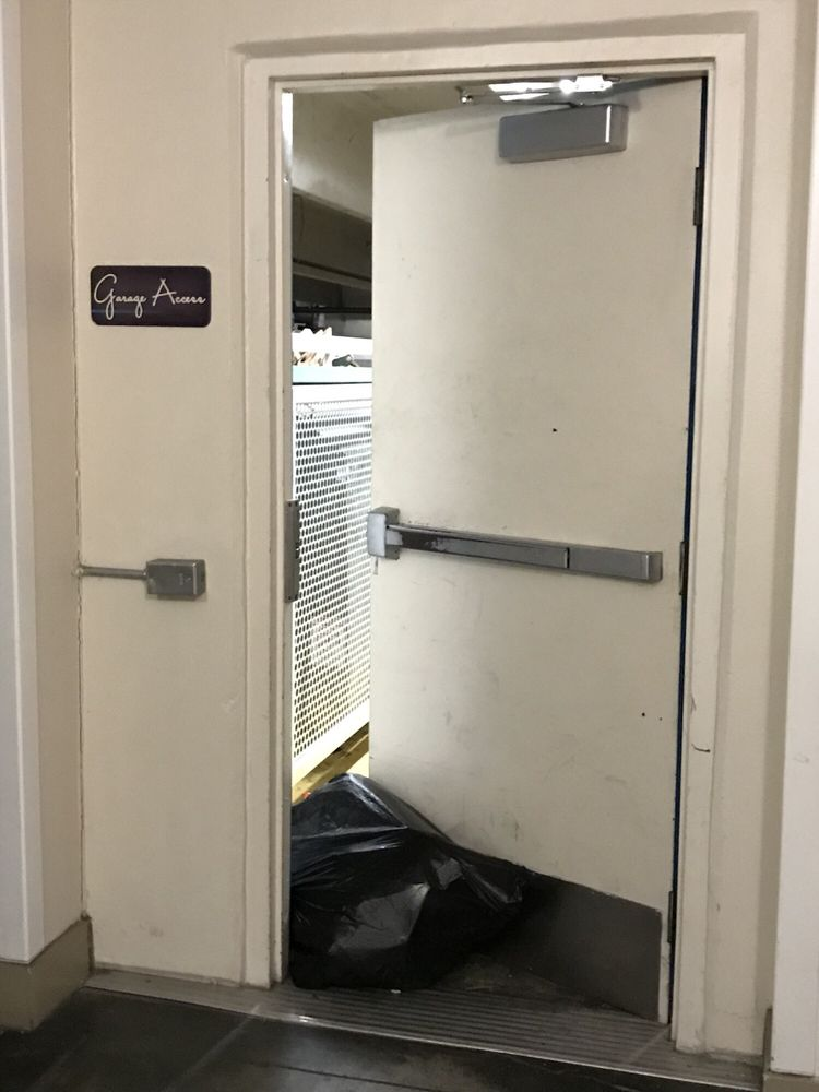Photo of Post South Lamar - Austin TX United States. Trash bag used & Trash bag used to prop open door that has been broken for over a ...