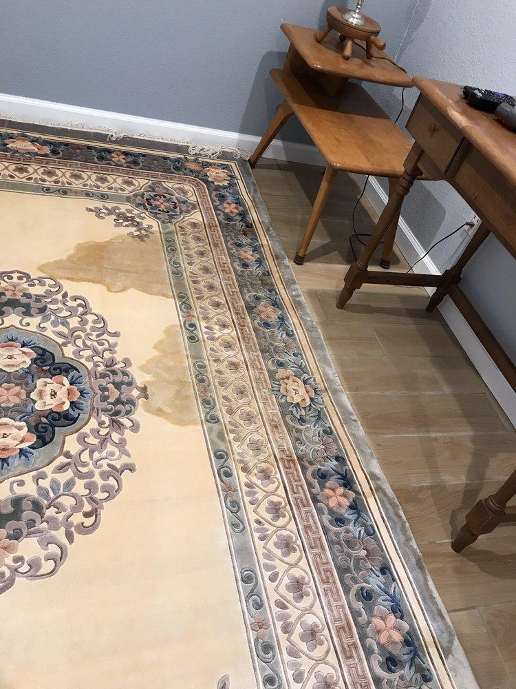 A bad water spot on my silk carpet