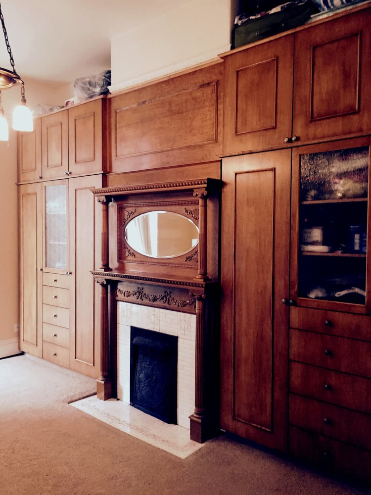 Matching Storage Cabinets Next To A 1910 Fireplace In San