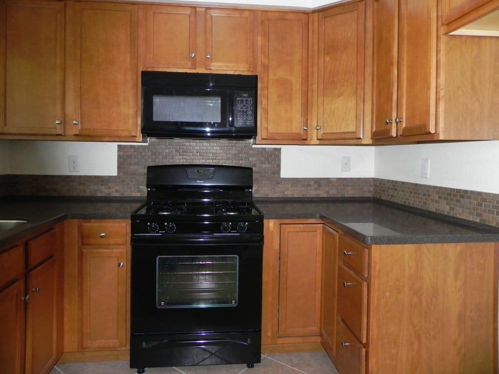 Birch Autumn Finish Cabinets Solid Surface Countertop Yelp