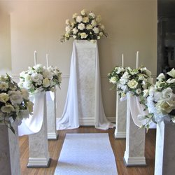 Photo Of Wedding Pillars And Petals