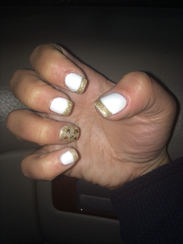 Gold and white French manicure gel nails with gold glitter accent ...