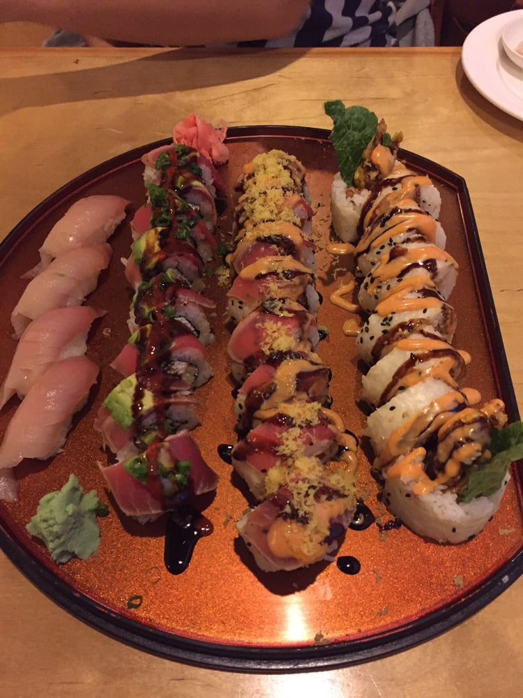 From Left To Right Two Orders Of Yellowtail Sushi Burning Woman