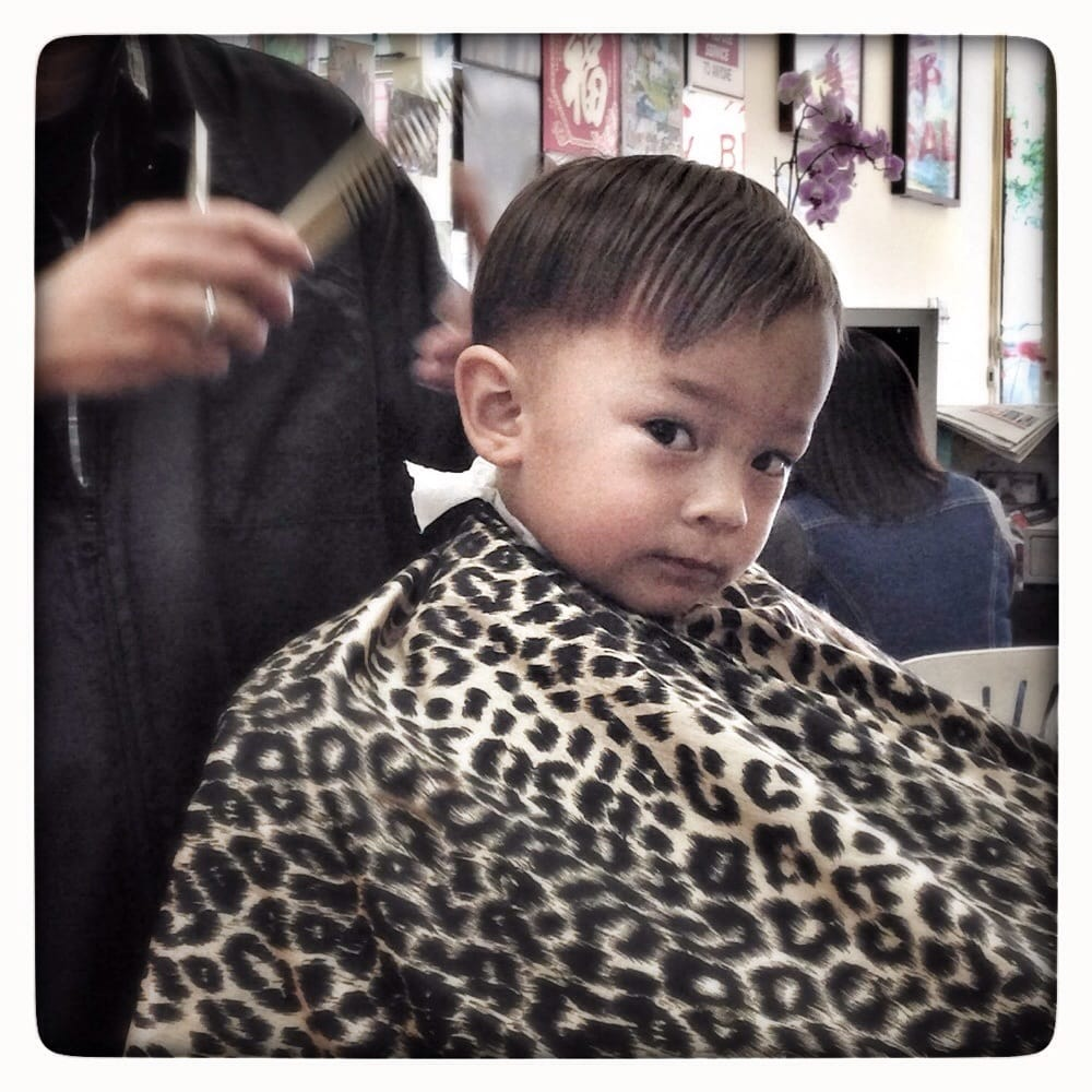 Griffin getting his hair cut by Ken at our local