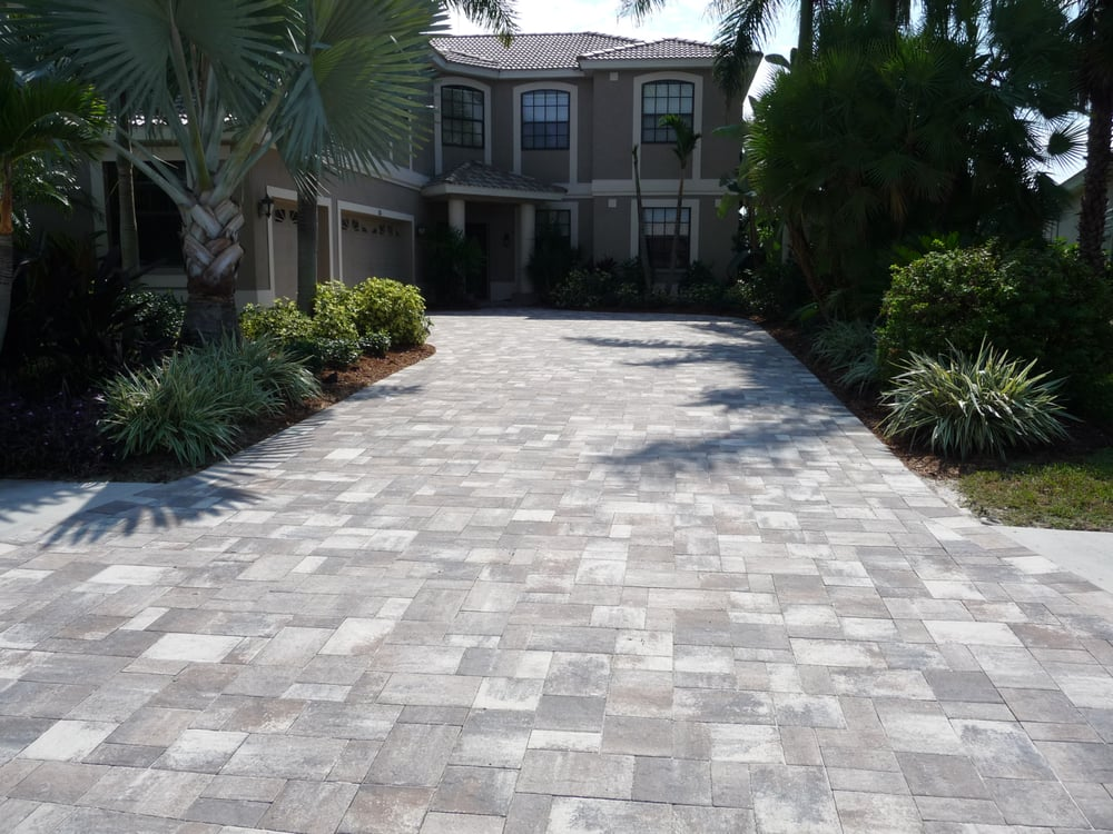 We install brick pavers on driveways flagstone pavers Flagstone pavers around pool