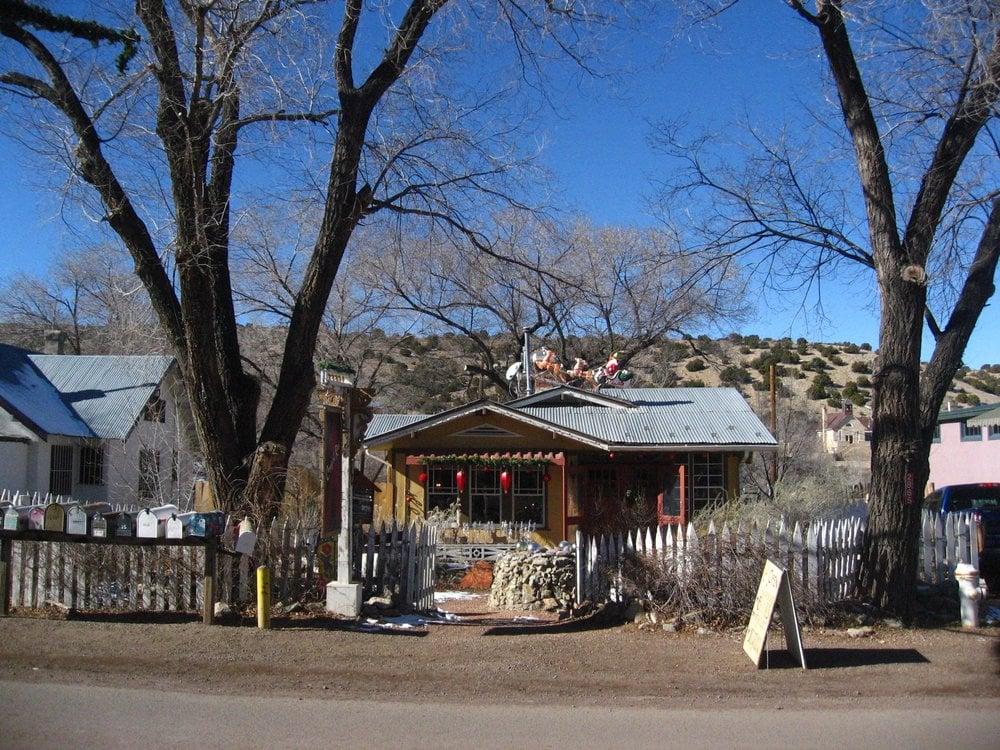 Cowgirl Red: 2865 State Hwy 14 N, Madrid, NM