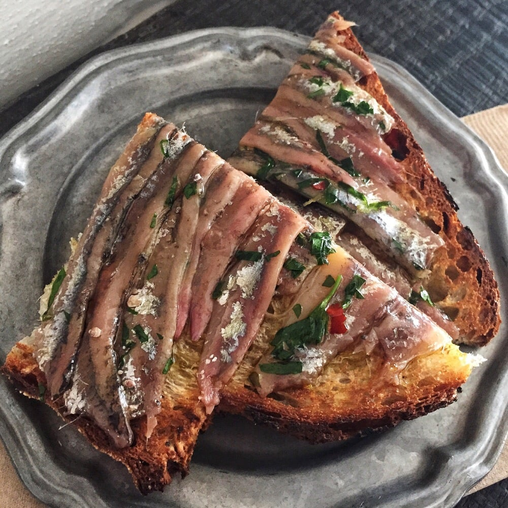 CA, United States. Anchovy toast. Salt cured Santa Barbara anchovies ...