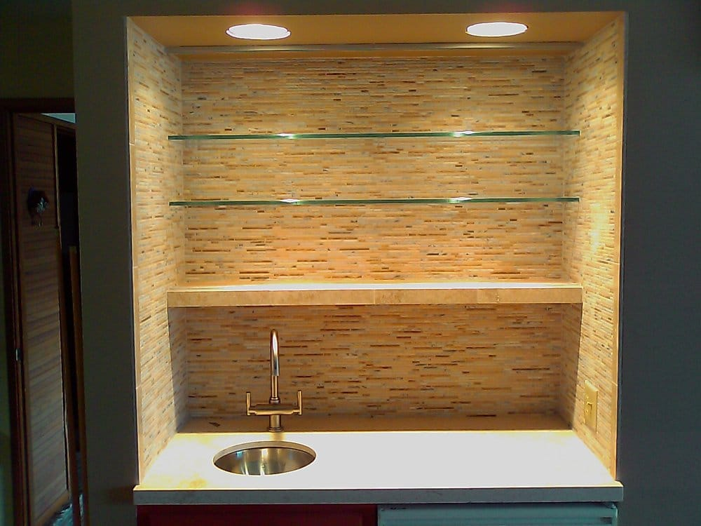 Bar area with glass shelves and travertine mosaic tile. - Yelp