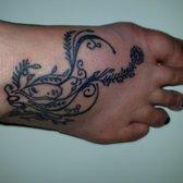 Capones tattoo parlor piercing 6412 w wilkinson blvd for North carolina tattoo laws