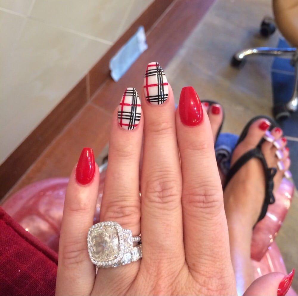 Kim Zolciak Burberry nails - Yelp