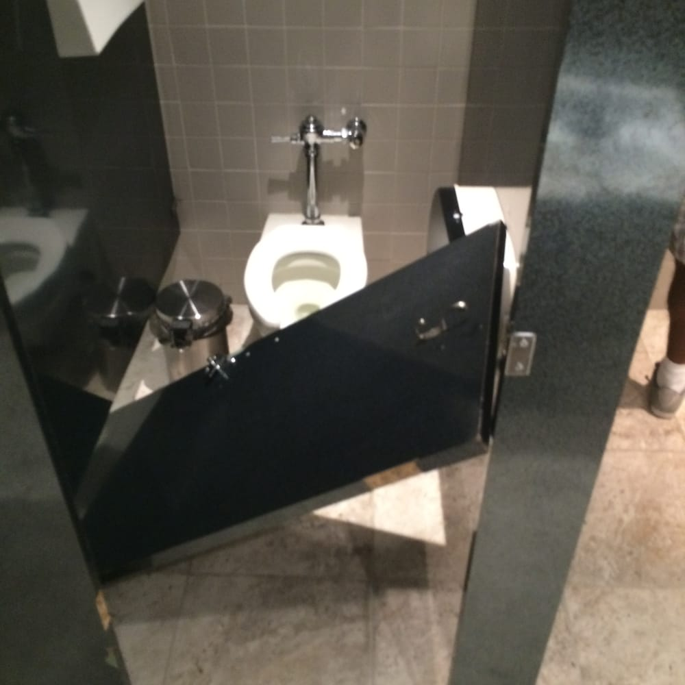 Mens bathroom stall door that fell on me when using the - Bathroom partition installers near me ...