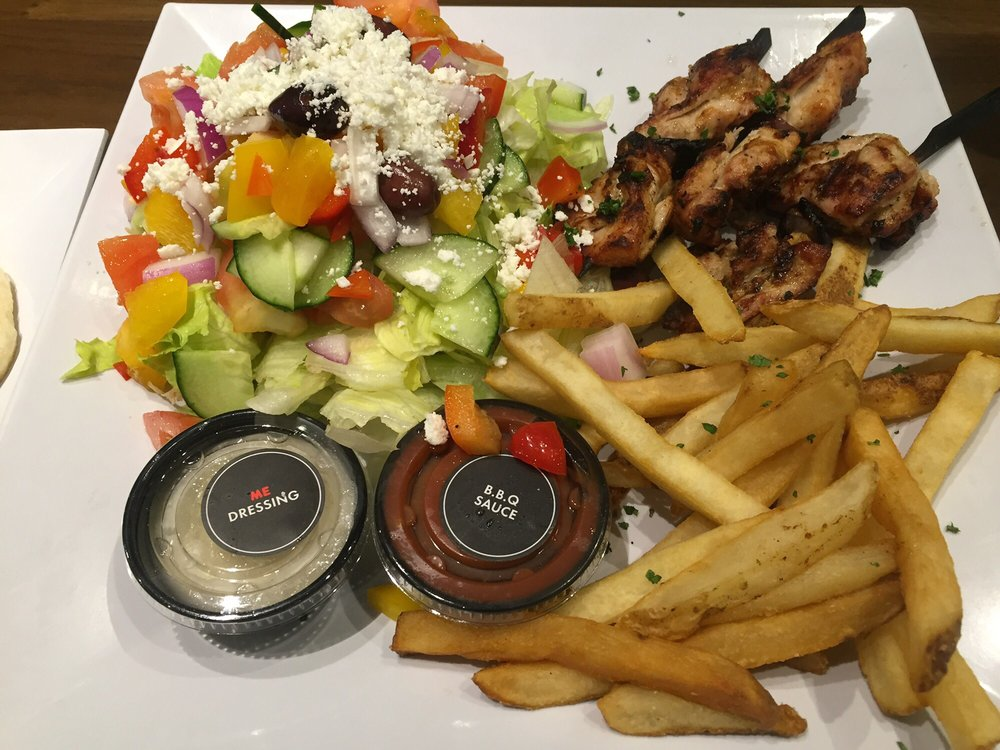 A Kitchen Is Launching An Express Lunch Service: Grilled Chicken Box With Fries And Greek Salad