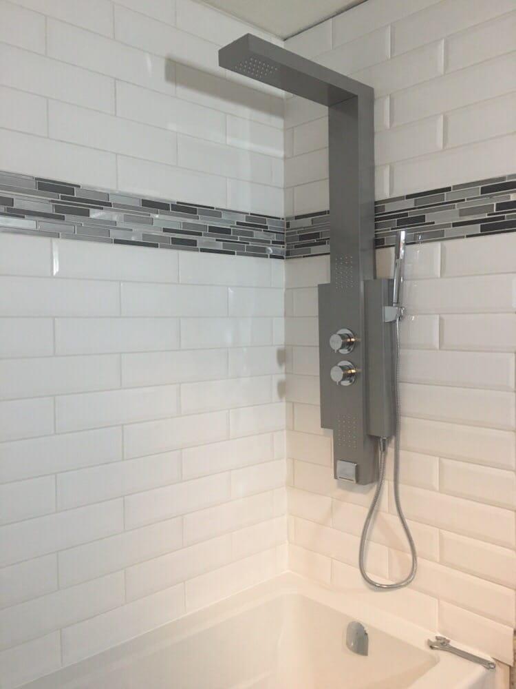 Recent bathroom renovation. New tub, new back splash and new shower ...
