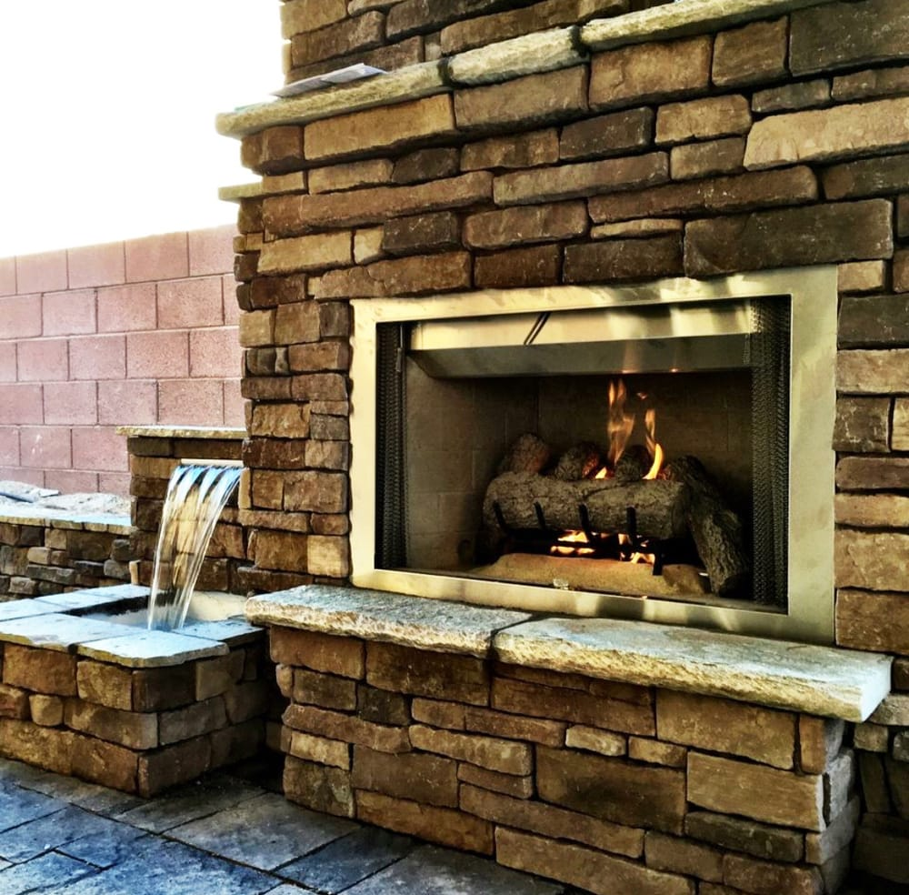 Outdoor fireplace/water feature combination - Yelp
