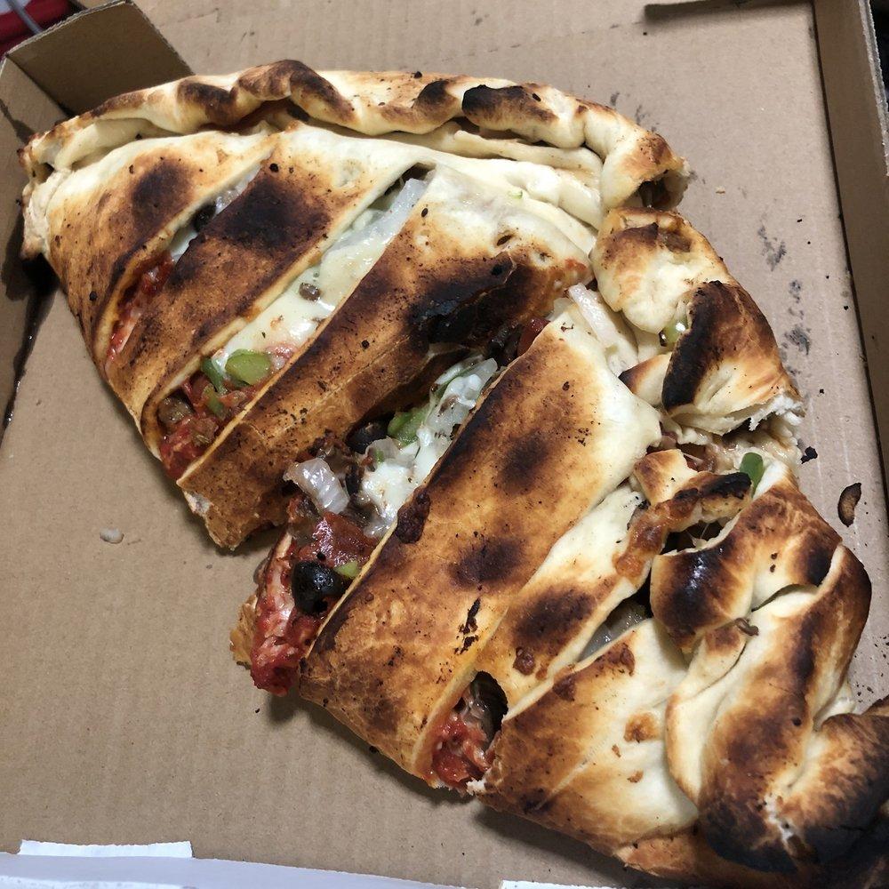 Kourtney Kay's Sutter Cut Pizzeria: 1939 Acacia Ave, Sutter, CA