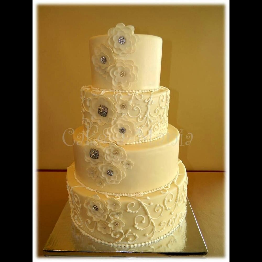 4 tier fondant wedding cake. Scroll patten and fondant fantasy ...