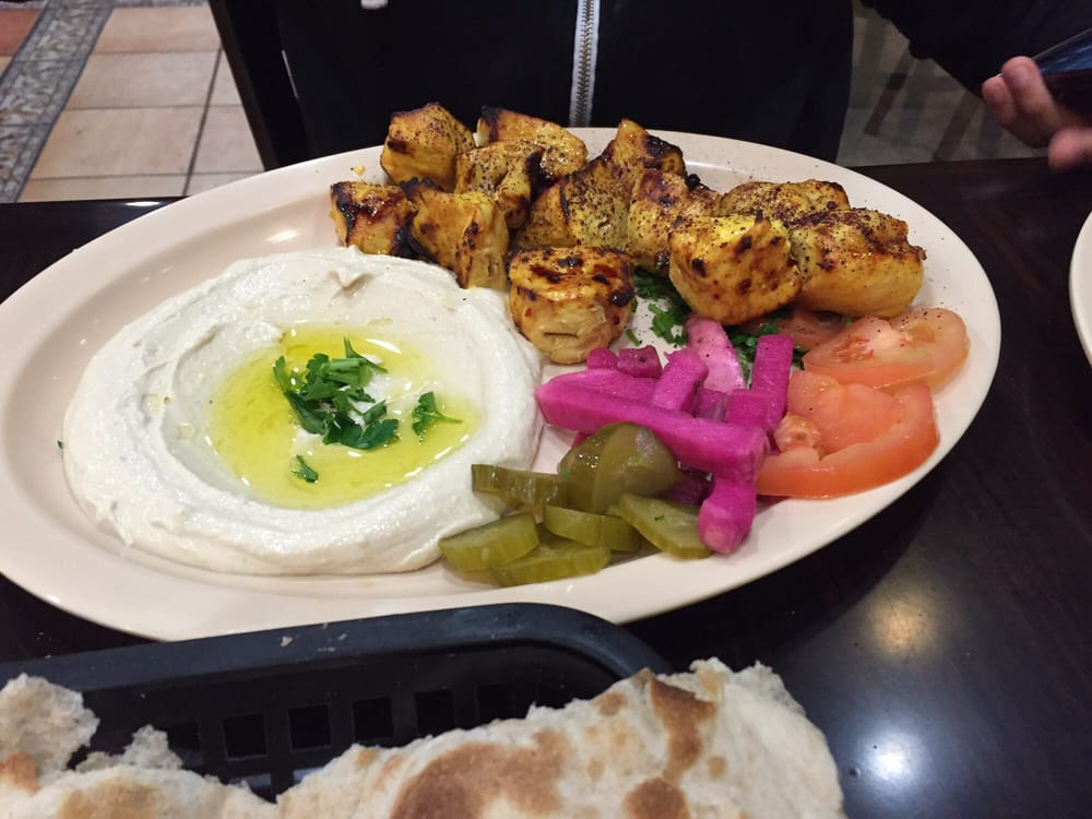 Chicken tekka plate with a side of hummus instead of rice for Al tannour mediterranean cuisine menu