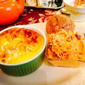 Photo of Olde English Tea Room - Wake Forest, NC, United States. quiche (western) with cinnamon muffin and carrot salad. So good.