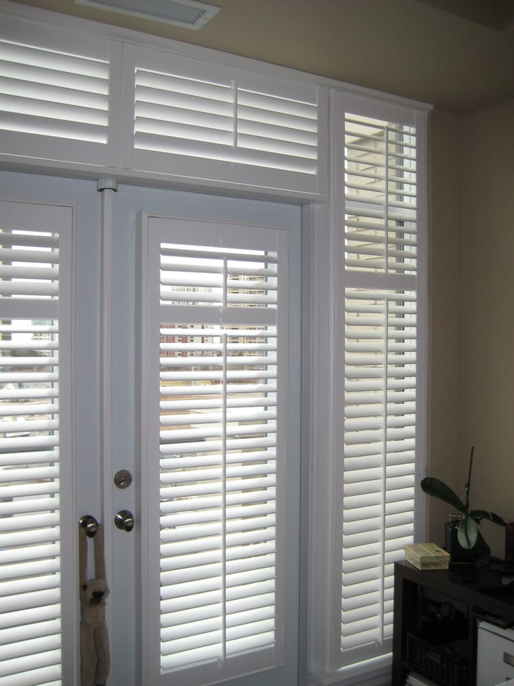 California Shutters In A Condo Setting Covering A Sunny