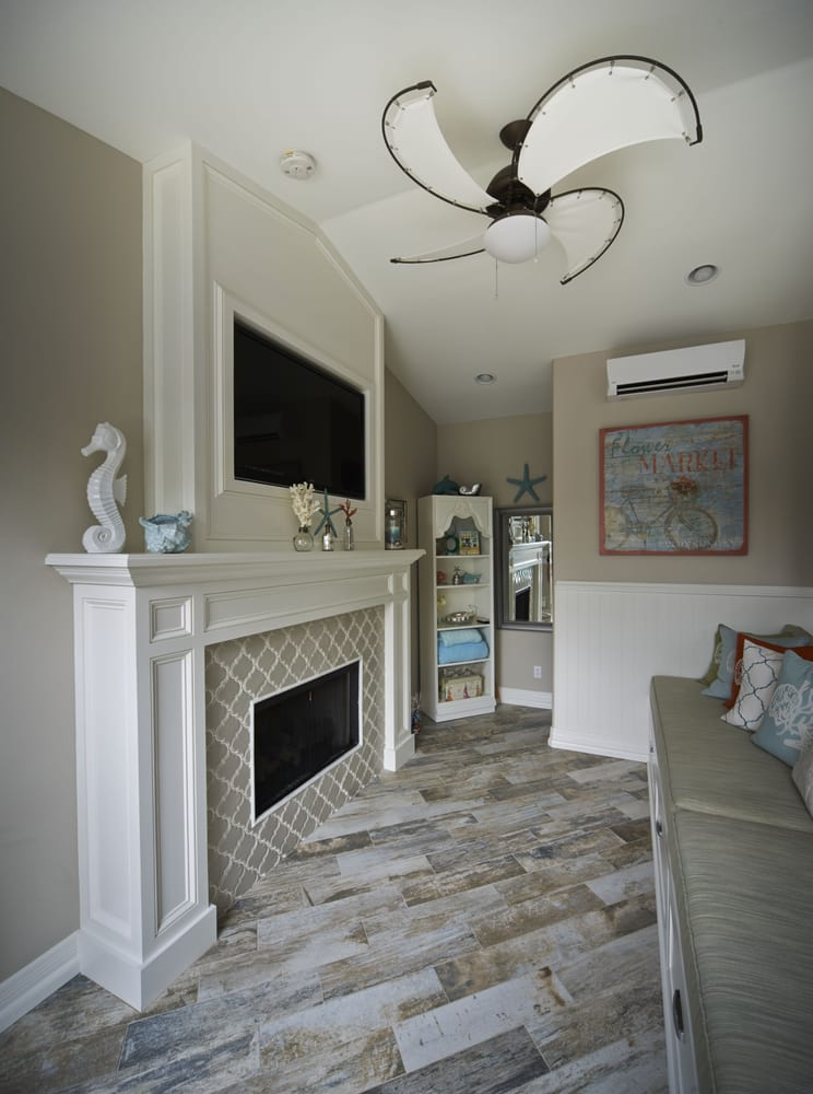 Hardwood crown moulding, panels and fireplace surround from