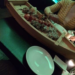 Sakura Japanese Cuisine - Astoria, NY, United States. We ordered five different rolls and it came out in this huge boat.