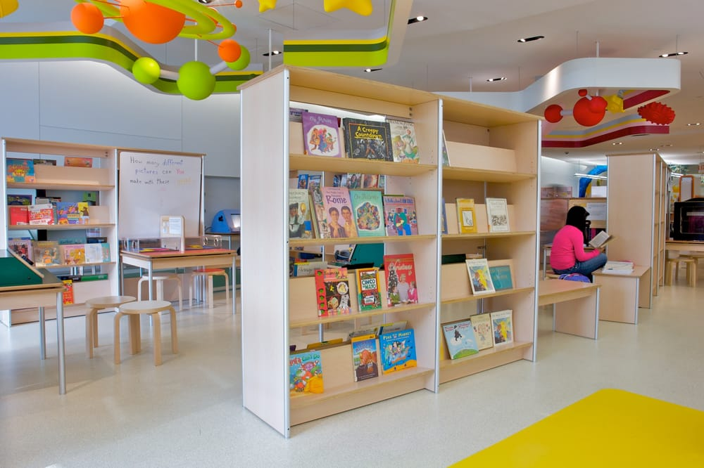 Library shelving at hte queens public discovery