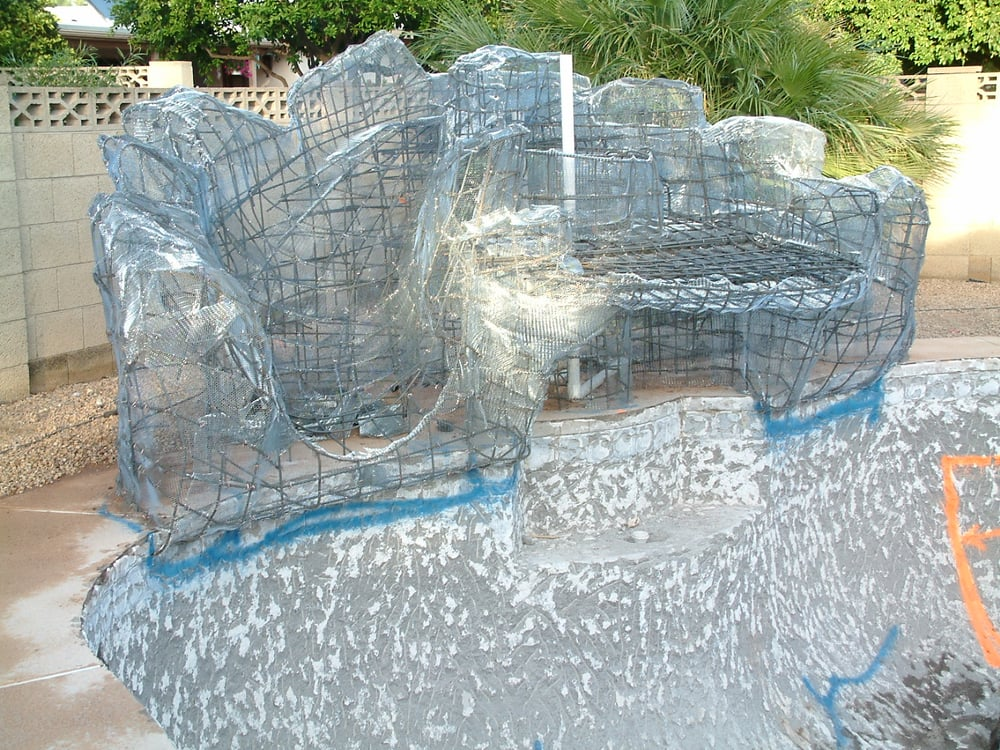 Forming phase of a grotto waterfall with slide steel and for Waterfall design phase