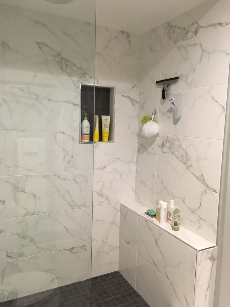 Shower tiling shown again with small \