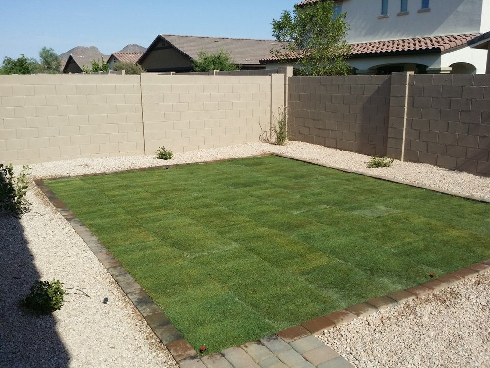Back yard installation, paver curb, sod, granite, shrubs and