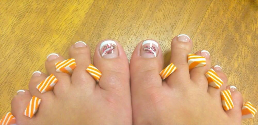 French pedicure with feather nail art on big toes. - Yelp