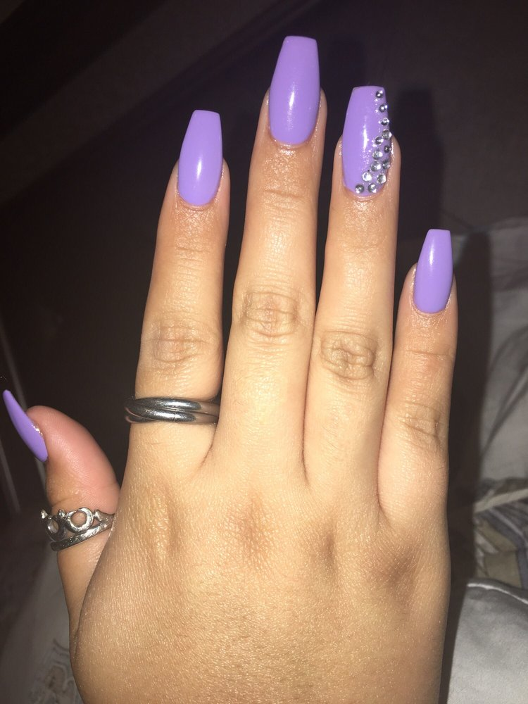 Acrylic coffin shaped nails with purple shellac on top and added ...