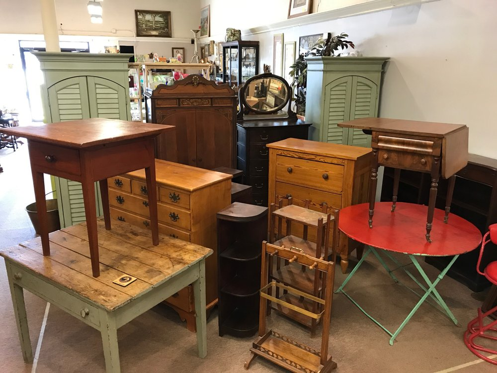 Antique furniture showcases in vendor booths yelp