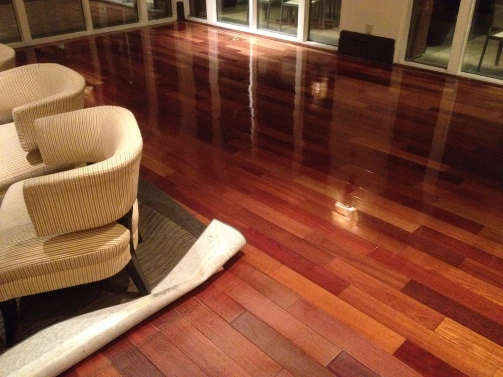 Buffing and finishing hardwood flooring of the ocean and for Custom hardwood flooring