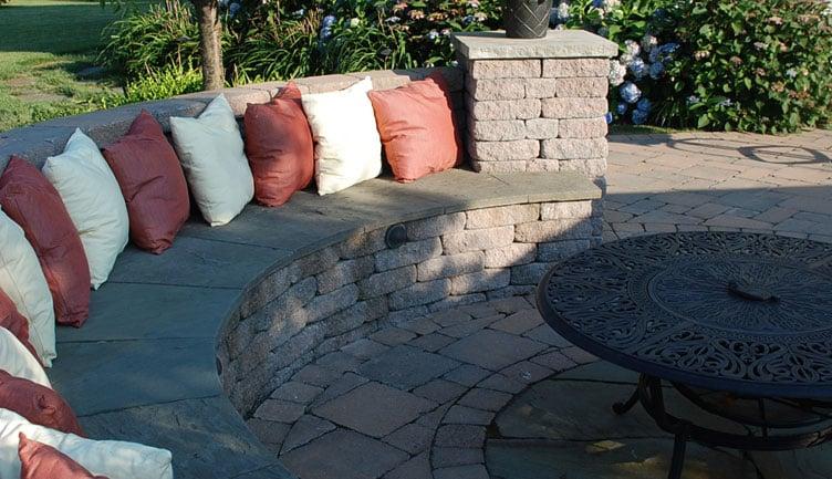 Decorative concrete block seating wall with bluestone caps. - Yelp