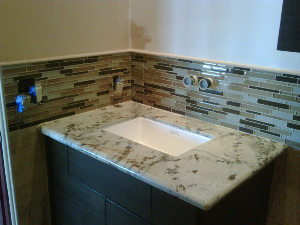 Granite Counter Top With Undermount Sink And Gl Tile Back Splash