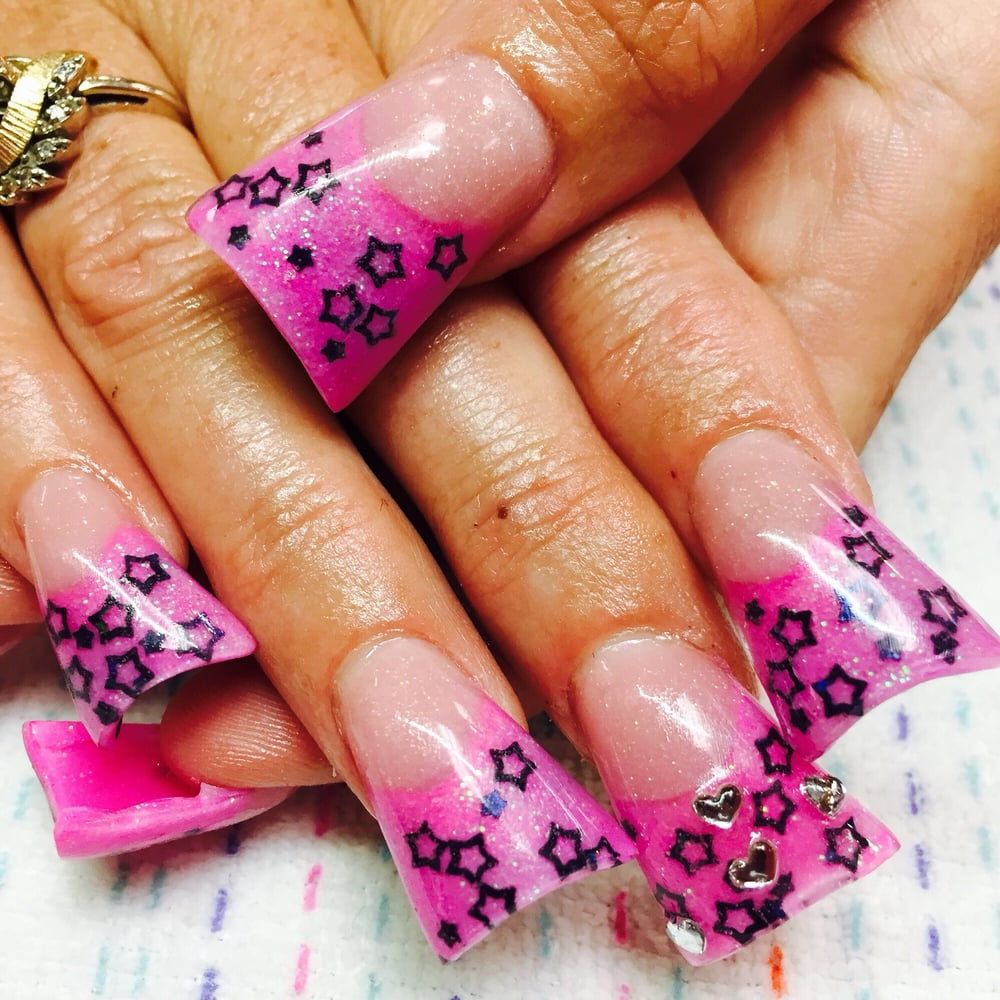 Pink glitter tips with black stars and heart rhinestones for 50th avenue salon