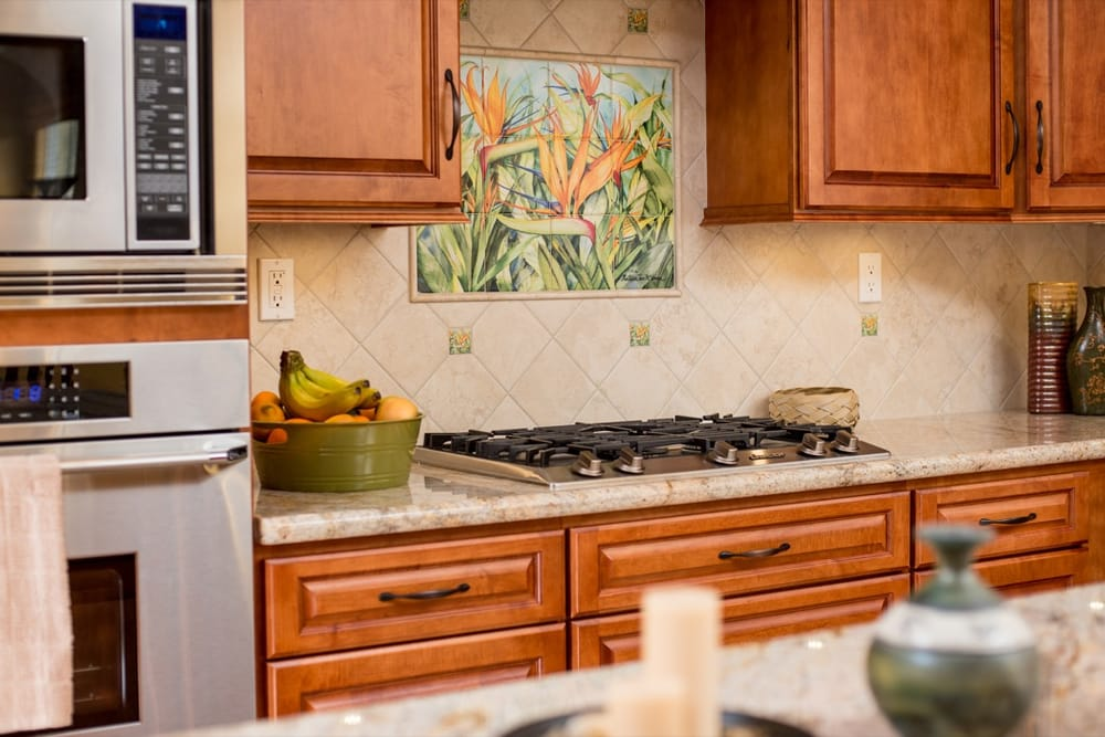 Kitchen remodel with gas stove top and custom backsplash Yelp