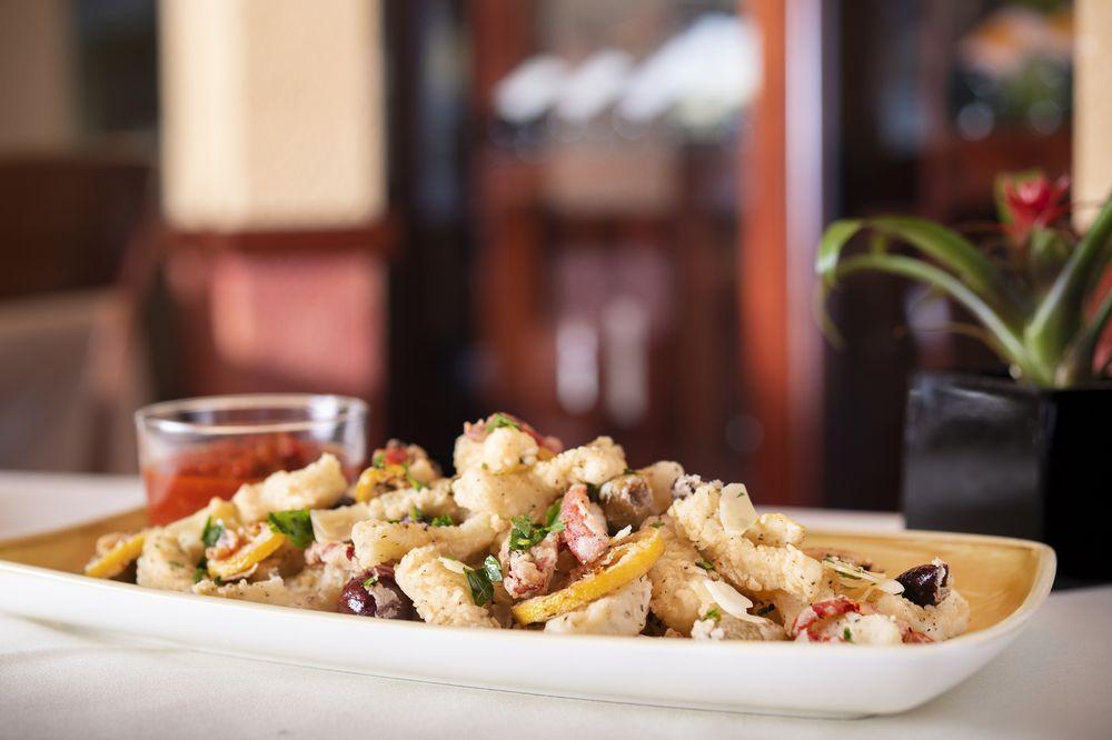 Palm Court Italian Grill: 5500 Gulf Blvd, St. Pete Beach, FL