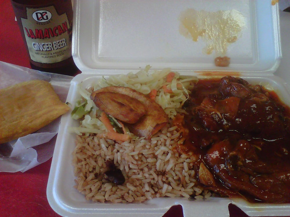 small stew chicken with rice and peas coleslaw and