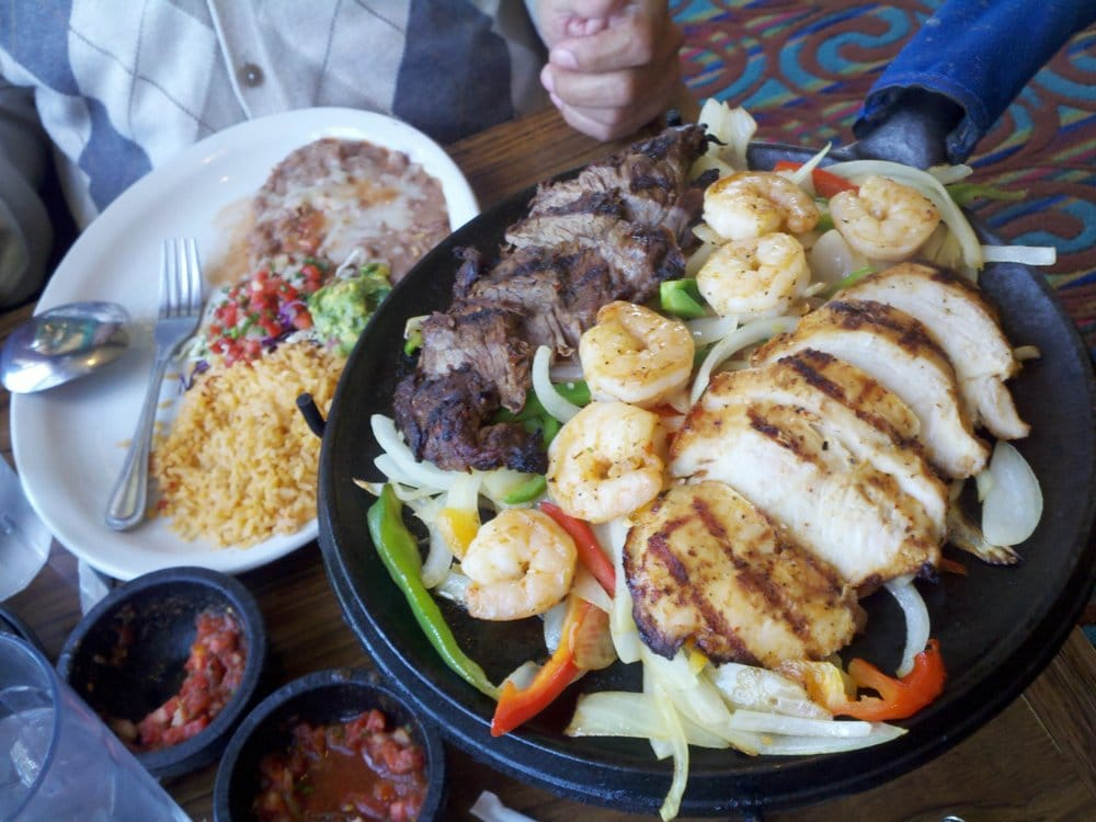 fajitas gigante on right comes with steak shrimp and