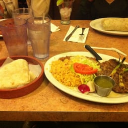 on background right and steak ranchero on background left yelp