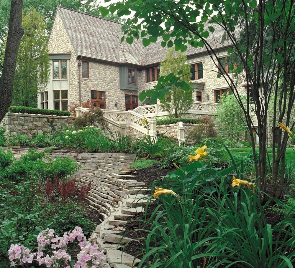 English garden wall in backyard landscape design stone for Landscape design associates