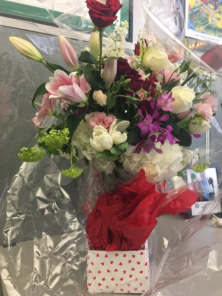 I love how the flowers are delivered covered with cellophane wrap photo of the garden gate dallas tx united states i love how mightylinksfo