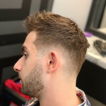 Low Skin Fade Haircut With Textured Top And Beard Sculpt