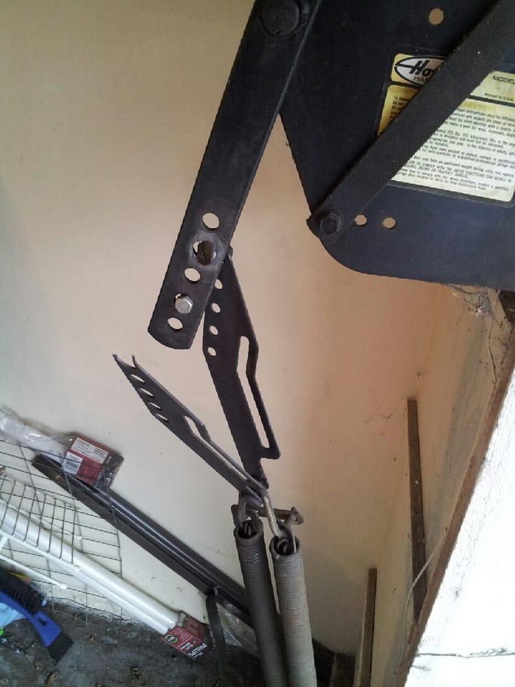 A broken e900 hinge on a wood flip up one piece door for 1 piece garage door