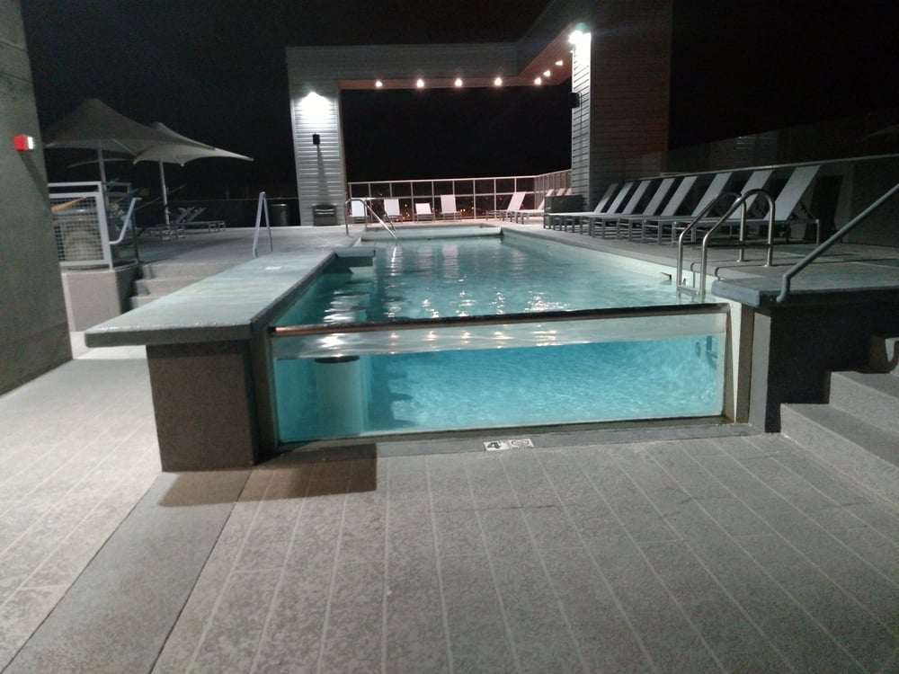 One Of A Kind Swimming Pool With A Glass Side Wall And On