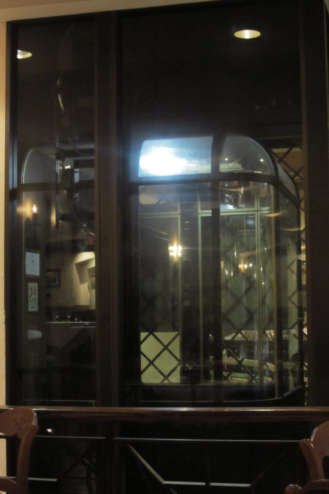 The indoor old fashioned glass elevator yelp for Indoor elevator