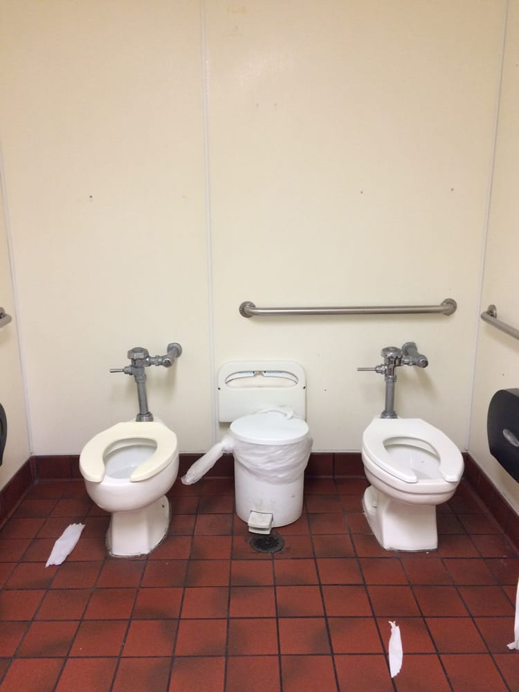 Weird women 39 s restroom with two toilets and no partition for Bathroom cleaning services near me