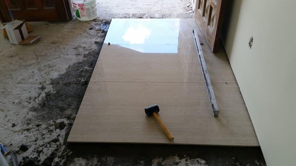 Starting phase of a 4ft x 2ft Porcelain tile floor. - Yelp