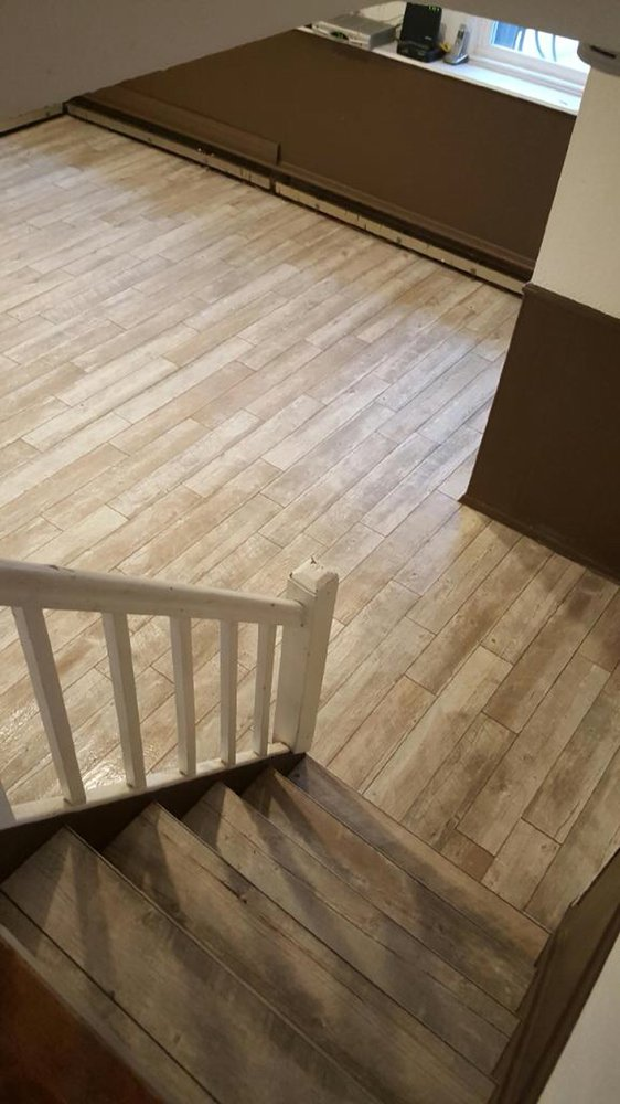 Ceramic Plank Tile Installation On Basement Stairs And Walls Yelp